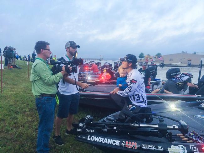 Stetson Blaylock holds his son Kei during the morning interviews at the TTBC on Lake Fork.