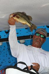 Darren Vieira shows off his co-angler trophy at the Cal Delta.