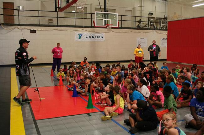 Pro Tom Redington talks about the importance of science and math at a local YMCA.