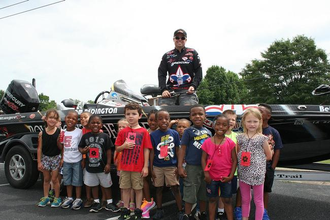 Boy Scouts pro Tom Redington poses with some of the students he mentored this week.
