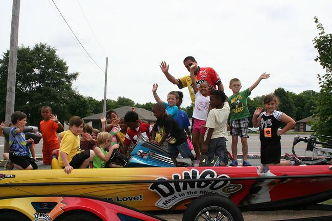 The Dingo boat was a crowd favorite. Here, Vic Vatalaro and a few of the YMCA camp attendees cheese it up for the camera.