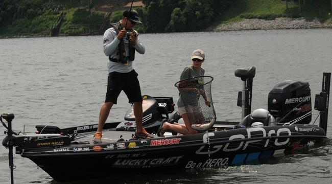 Co-angler Nichole Mara heaves Ehrler's catch into the boat