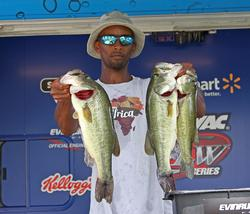 Sixth-place pro Omari Navies shows off his catch.