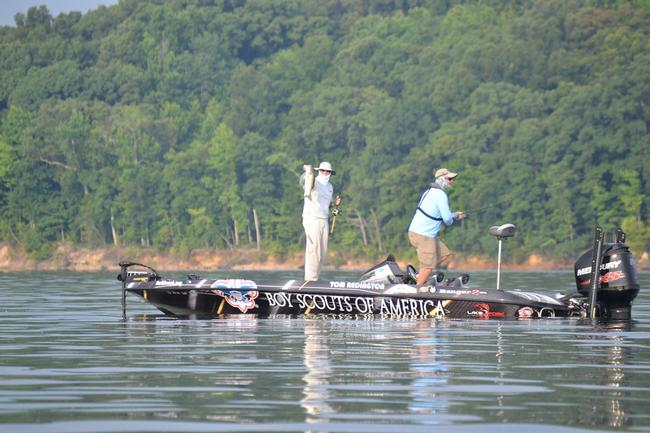 Texas pro Tom Redington is swathed in protective clothing and catching bass on day one of the FLW tour event on Kentucky Lake.
