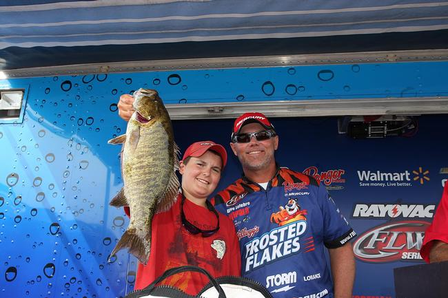 Kellogg's Frosted Flakes pro Dave Lefebre brought in 14 pounds, 12 ounces on day three to claim third place. A local fan of Lefebre's helped him show off his fish.