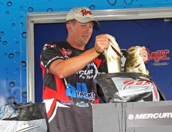 Bryan Schmitt loads his two biggest bass into the weigh-in basket.