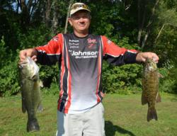 Co-angler Terry Holsapple displays his two best from his 13-4 bag.
