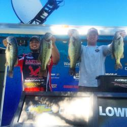 Nick Barr and Jarred Walker hold up their four biggest bass which carried them to a second place fish in the Western Invitational on Clear Lake.
