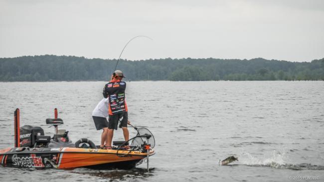 Zack Birge hauls a brush-pile bass to the net.
