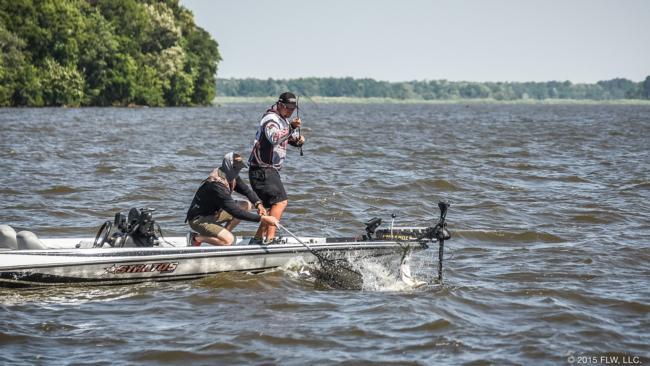 Clayton Batts fights a lunker boatside.