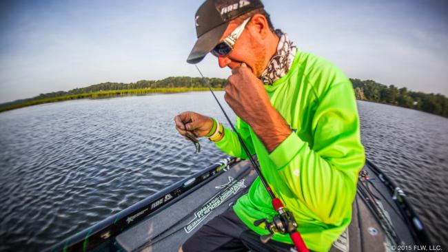 Avena paused to superglue the trailer back on his ChatterBait after a fish