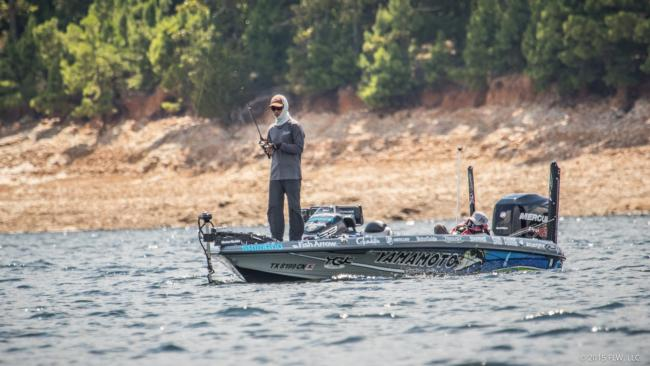 Hey! We found Shin Fukae. Shin was using spinning tackle and targeting what looked like was an offshore brush pile. We will see lots of anglers probing the depths of Lake Ouachita for a limit of bass this week. If you look closely you can also see Shin's wife, Miyu, sleeping in the passenger seat. ?