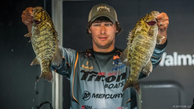Brandon Perkins hoists two of the slammer smallies he rode to second place and the Cup.