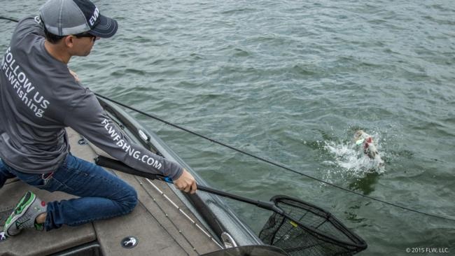 Jesse Schultz fights a smallmouth to the boat.