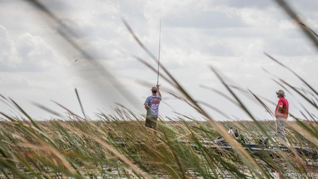 Chris Johnston flips high in the air to punch through a thick patch of reeds.
