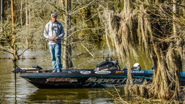 Glenn Browne fishes down a line of trees decked out with spanish moss.